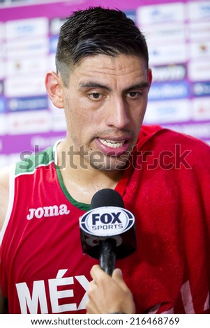BARCELONA, SPAIN - SEPTEMBER 6: Gustavo Ayon with journalists after the FIBA World Cup basketball match between USA and Mexico, final score 86-63, on September 6, 2014, in Barcelona, Spain. - stock photo