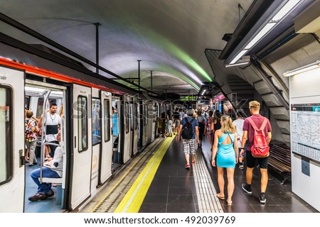 BARCELONA, SPAIN - SEPTEMBER 11, 2016: Interior of Barcelona metro station (Metro de Barcelona). The Barcelona metro network consists of 5 metro lines. People on the platform.