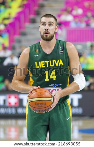 BARCELONA, SPAIN - SEPTEMBER 11: Jonas Valanciunas of Lithuania at FIBA World Cup basketball match between USA Team and Lithuania, final score 96-68, on September 11, 2014, in Barcelona, Spain. - stock photo