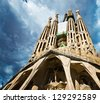 BARCELONA SPAIN - SEPTEMBER 13: La Sagrada Familia-the impressive cathedral designed by Gaudi, which is being build since 19 March 1882 and is not finished yet September 13, 2012 in Barcelona, Spain. - stock photo