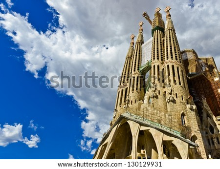BARCELONA SPAIN - SEPTEMBER 13: La Sagrada Familia - the impressive cathedral designed by Gaudi, which is being build since 19 March 1882 and is not finished yet September 13, 2012 in Barcelona, Spain - stock photo