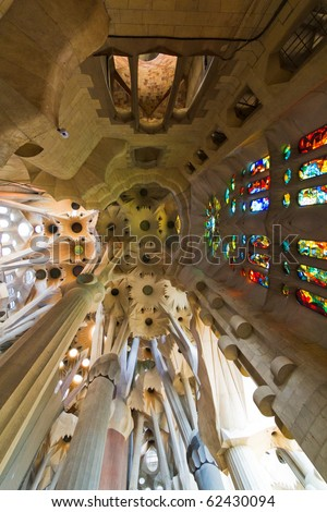 BARCELONA, SPAIN - SEPTEMBER 13: La Sagrada Familia - the impressive cathedral designed by Gaudi, which is being build since 1882 and is not finished yet September 13, 2010 in Barcelona, Spain. - stock photo