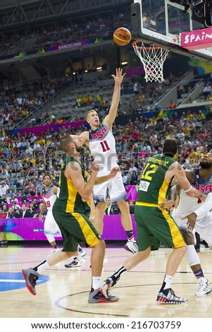 BARCELONA, SPAIN - SEPTEMBER 11: Mason Plumlee of USA (11) in action at FIBA World Cup basketball match between USA Team and Lithuania, final score 96-68, on September 11, 2014, in Barcelona, Spain. - stock photo