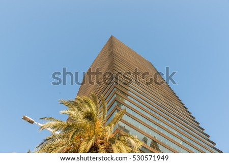 BARCELONA, SPAIN - SEPTEMBER 17; Modern office building low angle point of view of building corner towering skywards in Olympic Port district on September 17, 2016, Barcelona Spain