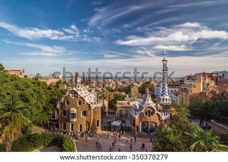 BARCELONA, SPAIN - SEPTEMBER 20, 2014: Park Guell by architect Antoni Gaudi in Barcelona, Catalonia, Spain. The two buildings at the entrance of the park. - stock photo