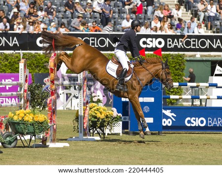BARCELONA, SPAIN - SEPTEMBER 25: Pedro Veniss from Brazil rides Norlam des Etisses at the 100th CSIO event at the Real Club de Polo Barcelona, on September 25, 2011, in Barcelona, Spain. - stock photo