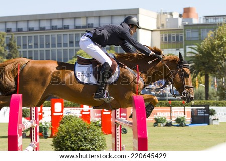 BARCELONA, SPAIN - SEPTEMBER 25: Pedro Veniss from Brazil rides Norlam des Etisses at the 100th CSIO event at the Real Club de Polo Barcelona, on September 25, 2011, in Barcelona, Spain.