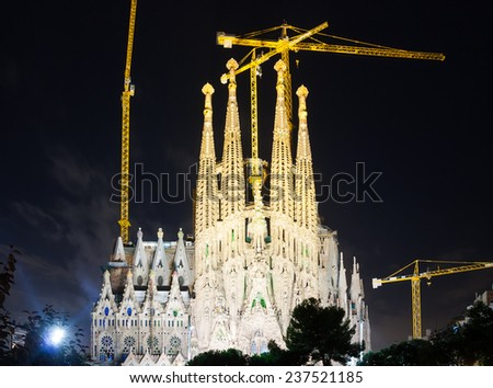 BARCELONA, SPAIN - SEPTEMBER 13, 2014: Sagrada Familia in dark time. Barcelona. Basilica and Expiatory Church of Holy Family by Gaudi, building is begun in 1882 and completion is planned in 2030 - stock photo