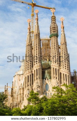 BARCELONA, SPAIN - SEPTEMBER 3: Sagrada Familia on September 5, 2012 in Barcelona, Spain. This cathedral was designed by famous spanish architect Antoni Gaudi and hadn't been finished till nowadays.
