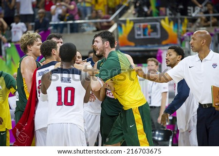 BARCELONA, SPAIN - SEPTEMBER 11: Some players arguing after the FIBA World Cup basketball match between USA Team and Lithuania, final score 96-68, on September 11, 2014, in Barcelona, Spain. - stock photo