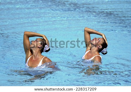 BARCELONA, SPAIN-SEPTEMBER 03,1999: Spain couple Gemma Mengual and Paola Tirados, during the swimming synchronized final of the Swimming World Championship, in Barcelona. - stock photo