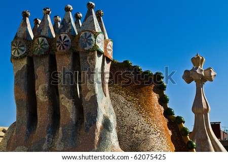 BARCELONA, SPAIN - 12 SEPTEMBER: The arched roof and chimney of Casa Batllo on september 12, 2010 in Barcelona, a building restored by Gaudi. The facade is decorated with a mosaic made of broken ceramic tiles. - stock photo