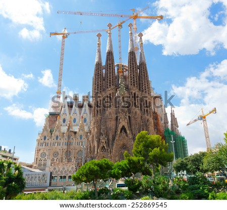 BARCELONA, SPAIN - SEPTEMBER 12, 2013: The Basilica of La Sagrada Familia . Designed by Antoni Gaudi, its construction began in 1882 and is not finished yet  - stock photo