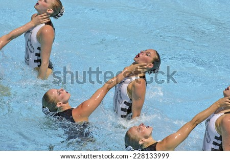 BARCELONA, SPAIN-SEPTEMBER 04,1999: United States swimming synchronized team in action during the World Swimming Championship, in Barcelona. - stock photo