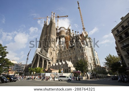BARCELONA, SPAIN - SEPTEMBER 13, 2014: View of the Passion Facade of the Basilica of the Holy Family (Sagrada Familia) in Barcelona, Spain - stock photo