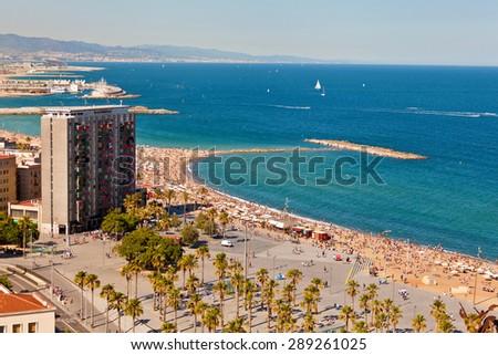 Barceloneta beach in Barcelona, Spain. Airview of the beach of Barceloneta. - stock photo