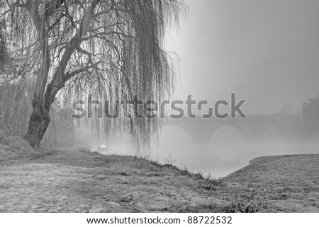 Barcelos historical part on a foggy morning (HDR black and white photo) - stock photo