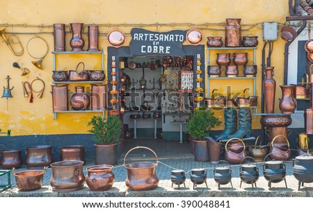 BARCELOS, PORTUGAL - 26 JUNE, 2010: Shop of objects made of copper in Barcelos, Portugal on 26 June, 2010. - stock photo