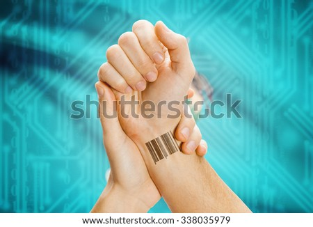 Barcode ID number tatoo on wrist and USA statesl flag on background - Oklahoma - stock photo