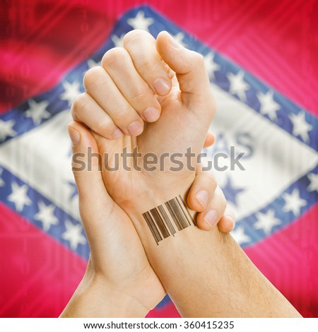 Barcode ID number tattoo on wrist and USA states flag on background series - Arkansas