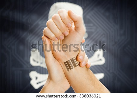 Barcode ID tattoo on hand and Jolly Roger flag on background - symbol of piracy - stock photo
