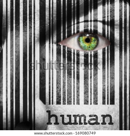 Barcode with the word human as concept superimposed on a man's face - stock photo
