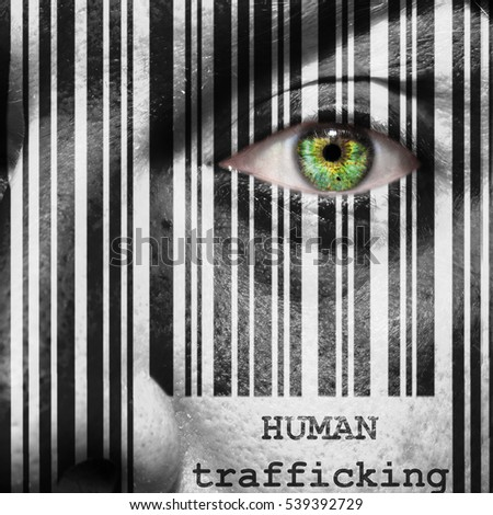 Barcode with the word human trafficking as concept superimposed on a man's face
