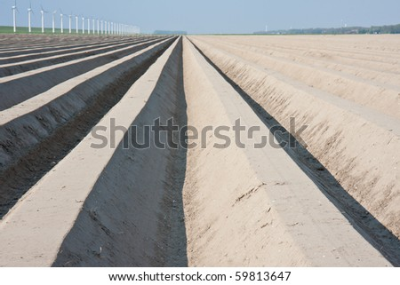 Bare farmland in the netherlands, waiting for spring - stock photo