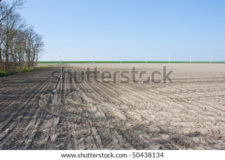 Bare farmland in the netherlands waiting for the coming spring - stock photo