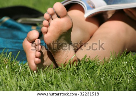 bare feet in the grass - stock photo
