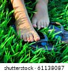 bare feet of girl on a grass - stock photo