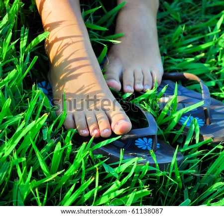 bare feet of girl on a grass