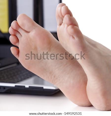 Bare feet on the desk