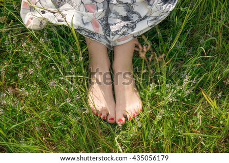 Bare foot on the grass in the park - stock photo