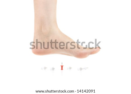 bare foot on the pushpin - stock photo