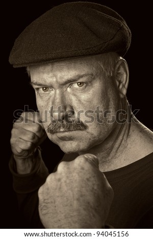 Bare Knuckle Boxer portrait in Sepia in Vintage pose from circa 1930. - stock photo