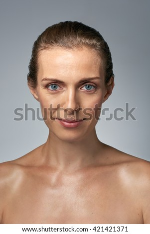 Bare natural portrait of beautiful mature middle age woman