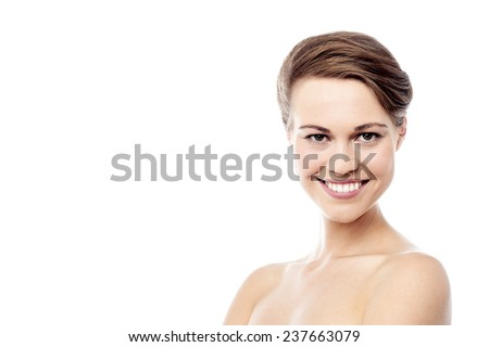 Bare shoulder woman looking into camera