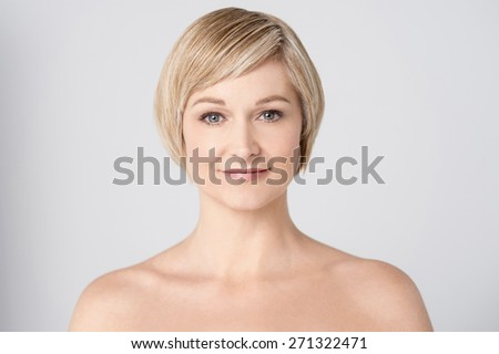 Bare shoulder woman posing to camera
