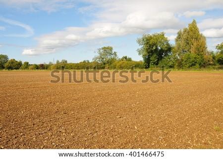 Bare Soil on Plowed Farmland - stock photo