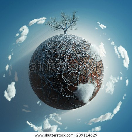 bare tree on small planet - stock photo