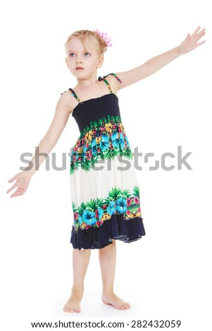 Barefoot blonde girl in summer dress waving his hands- isolated on white background - stock photo