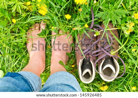 Barefoot in a flower field - stock photo