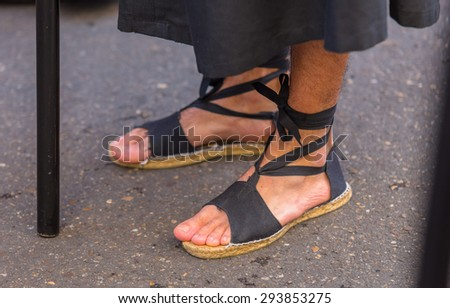 Barefoot Nazareno in the Holy Week in Valladolid. - stock photo