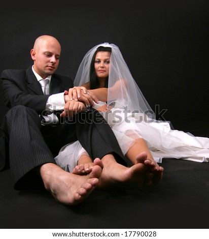barefoot newly married couple - stock photo