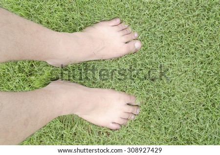 barefoot over fresh green grass