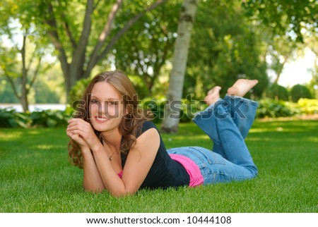 barefoot teen in lawn - stock photo