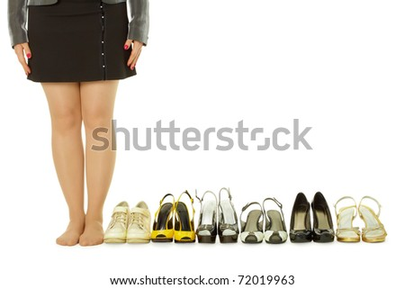 barefoot woman and lots of shoes on white - stock photo