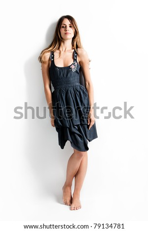 barefoot young woman in summer dress, studio shot, full body shot - stock photo