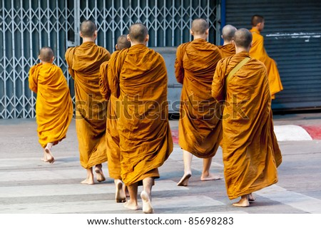 Barefooted buddhist monks in Chiang Mai Thailand - stock photo